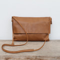 caramel genuine leather fold over crossbody bag with minimalist adjustable strap