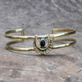 textured adjustable brass cuff with black onyx stone detail
