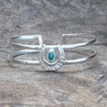 textured adjustable silver plated brass cuff with turquoise stone detail