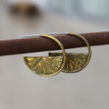 medium sized brass hoop earring with radial texture