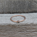14 carat rose gold plated sterling silver stacking ring with raw diamond detail