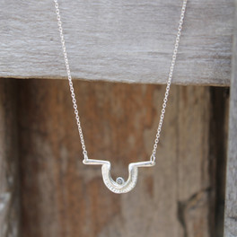 Textured pendant with raw diamond on sterling silver chain