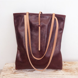 genuine red leather tote with simple tab closure