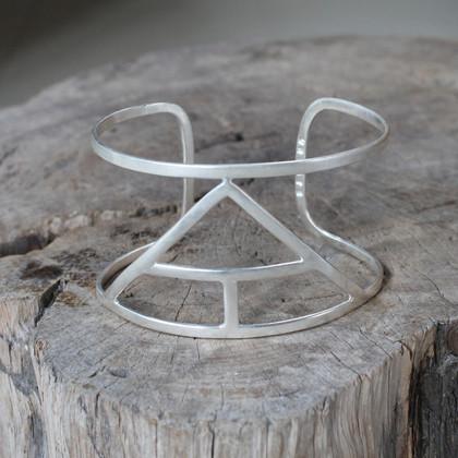 silver statement cuff featuring Create glyph symbol