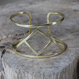 brass statement cuff featuring Transition glyph symbol