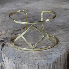 brass statement cuff featuring Transition glyph symbol