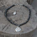 silver 'transition' glyph bracelet with genuine hematite stones