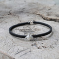 black leather bracelet with silver nautical star detail