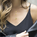 delicate gold necklace with feminine pendant
