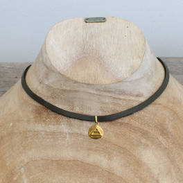 "grey leather necklace with brass ""explore"" pendant"