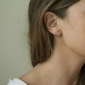 Silver XO earrings on a sterling silver post