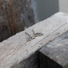 Silver XO earrings on a sterling silver post