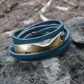 Thin teal leather multi wrap bracelet with antique brass wavy detail