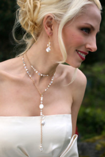 Coin Pearl Lariat in 18K Gold Vermeil shown with the Coin Pearl Cluster Earrings in 18K Gold Vermeil.