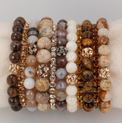 Gemstone &amp; Swarovski Crystal Stretch Bracelets shown in 7mm Bronzite, Light Colorado Topaz Swarovski Crystal, 7mm Fossilized Agate, 10mm Jasper, Crystal (Clear) Swarovski Crystal, 7mm Botswana Agate, 7mm Mother of Pearl, Crystal Dorado Swarovski Stretch Bracelet, 7mm Tiger&#039;s Eye, Smoked Topaz Swarovski Crystal, 7mm Jasper
