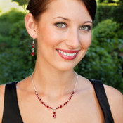 Crystal Lite Necklace in Sterling Silver Siam (Red) shown with the Crystal Dangle Earrings in Siam (Red).