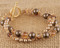 Double Bracelet shown in 18K Gold Vermeil Sandy Beach - Bronze & Brown Swarovski crystal pearls with Light Colorado Topaz & Smoked Topaz Swarovski crystals.