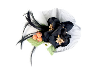 Flower fascinator with green leaves and feather