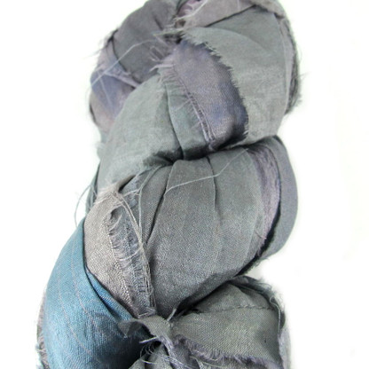 Grey Tone Sari Silk, made from recycled fair trade silk. has lovely blue and lilac colours throughout the mix. Great for bracelet making, weaving and jewellery making. Sold per 3 Meter Lengths