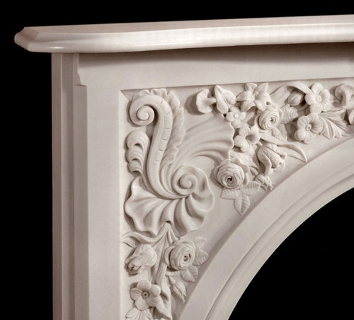 The Andrea marble mantel has beautiful floral details in the corners