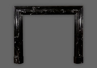 Amazing artwork crafted into the #108 Bolection marble mantel.  Black Regal with white veining