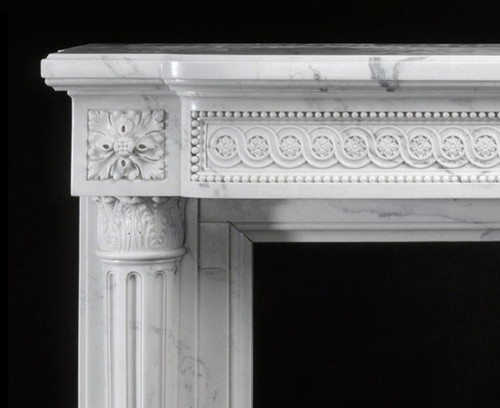 The Louis XVI Marble Mantel features acanthus leaf boss, with fleuron, decorate the corners, above the Corinthian Capitals