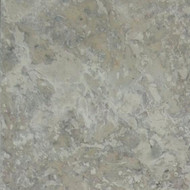 Walnut travertine stone fireplace facing has greys, browns and other warm earth tone colors