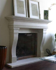 A beautifully proportioned stone mantel