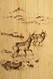 A small deer herd vignette on rustic paneling