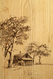 A rustic cottage appears in this wood paneling vignette