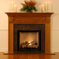 There is dentil molding and decorative trim molding on this mantel