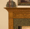 The legs of the Hanceville Fireplace Mantel are fluted