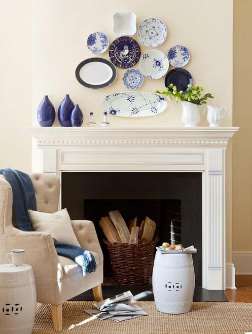 A wood fireplace mantel with detailed moldings and fluted legs for design inspiration