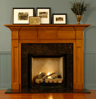 Be the envy of your friends with this gorgeous custom wood fireplace mantel featuring tiered panels, blocks and dentil molding