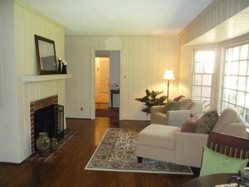 This random plank (9-groove) birch veneer paneling was installed then painted white for a cozy family room