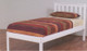Kado Bed Frame is made from pine and finished in low gloss white finish or walnut stain.