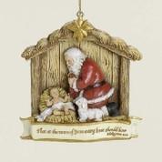 Kneeling Santa Christmas Ornament Scripture Lamb Resin measures 3 and 1 half inches RO39546