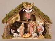 Nativity Stable Fontanini Wood Bark and Moss Accents measures 19 and 3 quarter inches wide by 14 inches tall by 10 inches deep RO50829