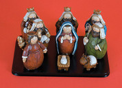 9 Piece Traditional Nativity is Carved Wood Look Resin Includes Jesus Mary Joseph 3 Kings 1 Angel 1 Shepherd and  1 Ox Includes Base Pieces measure 3 and one half inches tall LRI307013
