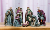 7 Piece Traditional Nativity Set Includes Infant Jesus Mary Joseph 3 Kings and 1 Angel in Muted Tones With Purple Accents tallest piece measures 8 inches TRIX6423