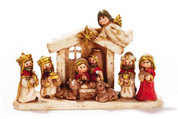 1 Piece Children's Nativity Miniature With Stable  resin measures about 3 and 1 quarter inches