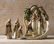 8 Piece Contemporary Nativity Set Wood look ivory tones with gold accents made of resin includes Jesus Mary Joseph 3 Kings and Bethlehem Backdrop largest piece measures 14 and 1 half inches tall RAZ3416393