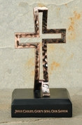 Ichthys Tabletop Cross appears as cross from front and fish from side bronze finished resin cross on wood base measures 6 and 1 eighth by 3 and 1 half by 3 and 1 half inches RO65289