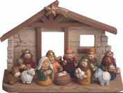 11 Piece Childrens Nativity Set Includes Infant Jesus Mary Joseph 1 Lamb 1 Donkey 1 Ox 1 Shepherd 1 Angel and 3 Kings Carved-Wood Look Pieces Tallest Piece is 4 inches Stable Included made of Resin TRIX9494