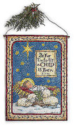 For Unto Us Wall Hanging Canvas shows Baby Jesus and lambs with words unto us a child is born measures 31 inches tall