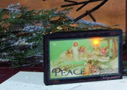 Peace Lighted Canvas Vintage Style Art or Ornament Angels Present Lighted Tree to Christ Child Lighted measures 5 and 1 half by 3 and 1 half inches OWX46235A