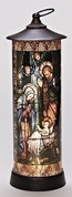 Nativity Lantern shows Holy Family in Stained Glass Look LED Light Resin and PVC measures 16 by 5.5 inches battery not included O164094