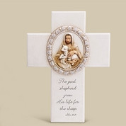 Good Shepherd Wall Cross Jesus and Lamb On White Cross imprinted with John 1 11 made of Resin Stone Mix measures 8 and 1 quarter y 6 inches RO66995