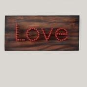 Love Wall Plaque Red Nails Spell Out LovE  Wood 4 and 1 half by 1 and 3 quarters inches RO10573
