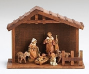 6 Piece Fontanini Nativity Set Includes Jesus Mary Joseph 1 Angel and 2 Lambs and Stable measuring 9 and 1 half by 12 and 1 half by 5 and 1 quarter inches RO54780